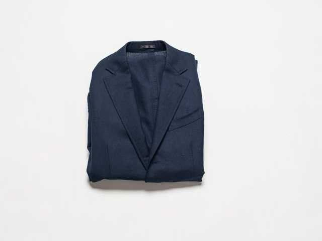 how-to-fold-a-suit-and-shirt-in-a-suitcase